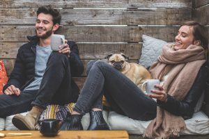 Couple relaxing with pug